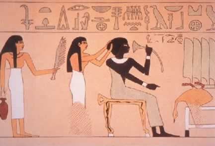 Black Egyptian queen being waited on by white servant